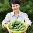 Woman-gardener with fresh cucumbers — Stock Photo