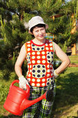 The woman-gardener with a watering can — Stock Photo