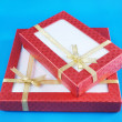 Gift boxes on blue background — Stock Photo