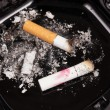 Stock Photo: Cigarette butts in ashtray