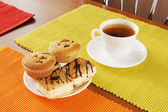 Fresh cakes and tea on the table — Stock Photo