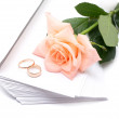 Rose, envelopes and wedding rings on a white background — Stock Photo