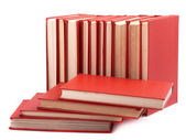 Pile of red books on a white background — Stock Photo