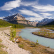 Canadian landscape with river, mountains and cloudy sky — Stock Photo