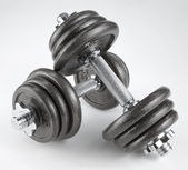 Pair of heavy dumbbells — Stock Photo