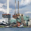 Large power plant beside a river - Stock Photo
