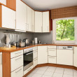 Modern kitchen with view into the garden - Stock Photo