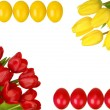 Easter frame with yellow and red tulips and eggs - Stock Photo