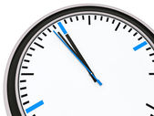 Clock one minute for twelve — Stock Photo
