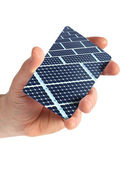 Card hand with solar panel — Stock Photo