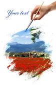 Hand that paints a landscape — Stock Photo