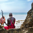 Maasai sitting by the ocean - Stock Photo