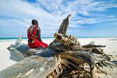 Maasai sitting by the ocean — Stock Photo