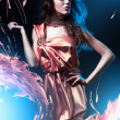 Stock Photo: Slim beautiful womin pink dress and paint splash