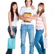 Students stand with yellow notebook and packages - Stock Photo