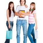 studenten staan met gele laptop en pakketten — Stockfoto
