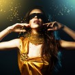 Woman in yellow dress and mask with jewelry — Stock Photo #9035943