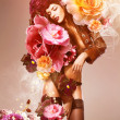 Stock Photo: Beautiful erotic sexy flower womin jacket and flowers