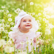 Funny little girl on the field — Stock Photo