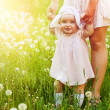 Happy child with mother on the field — Foto Stock