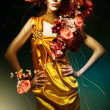 Stock Photo: Sensual beautiful woman in long yellow dress and flowers
