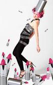 Girl with pink lipsticks — Stock Photo