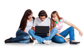 Students siting with laptop — Stock Photo