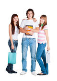 Students stand with yellow notebook and packages — Stock Photo