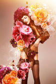 Beautiful erotic sexy flower woman in jacket and flowers — Stock Photo