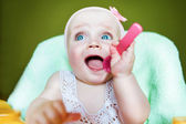 Cute kid with pink spoon — Stock Photo