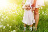 Happy child with mother on the field — Stock Photo