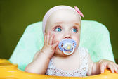 Little cute child with baby's dummy in mouth — Stock Photo