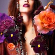 Erotic woman with silver accessory in flowers — Stock Photo #9166193