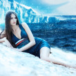Woman in dress on the snowy beach and iceberg — Foto de Stock