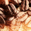 A lot of coffee beans on drapery with sparkles — Stock Photo