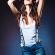 Sexy beautiful woman in hat and shorts with suspenders — Stock Photo