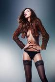 Beautiful erotic sensual woman in jacket and panties — Stock Photo