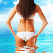Slim healthy woman body in the sea water — Stock Photo #9269194