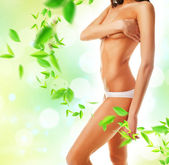 Beautiful woman body and leaves — Stock Photo