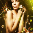 Beautiful woman with flower around crystal stars — Stock Photo