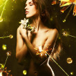 Beautiful woman with white flower around crystal stars — Stock Photo