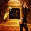 Pretty erotic woman in mask in theater — Stock Photo #9282773