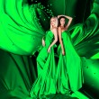 Two women in green dress with long hair and hearts on red draper — 图库照片