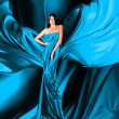 Stock Photo: Womin blue dress