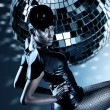 Attractive african woman with disco ball - 图库照片