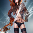Beautiful erotic sensual woman in jacket and panties with violin — Stock Photo