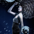 Girl with a lot of curly hair and disco balls — Stock Photo