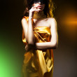 Sensual adult woman in golden dress and black mask — Stock Photo