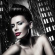 Sexy brunette woman with red lips in rainy city — Stock Photo #9285051