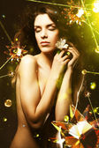 Beautiful woman with flower around crystal stars — Stockfoto